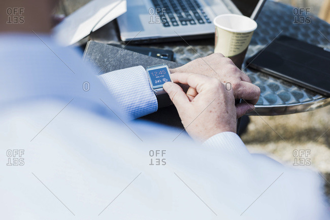 Close up of a businessman checking time
