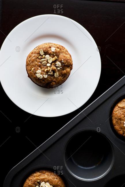 An oatmeal muffin fresh from the baking pan