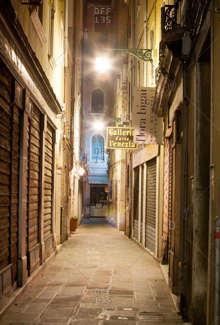 Venice, Italy - March 17, 2007: Narrow street at night in Venice, Italy