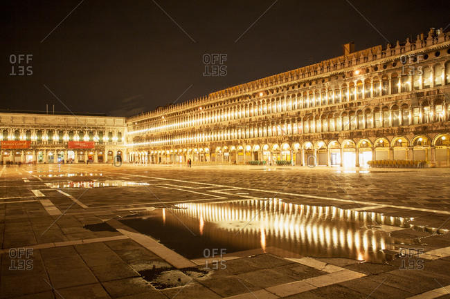 Venice, Italy - March 20, 2015: Piazza San Marco lit up at night in Venice, Italy