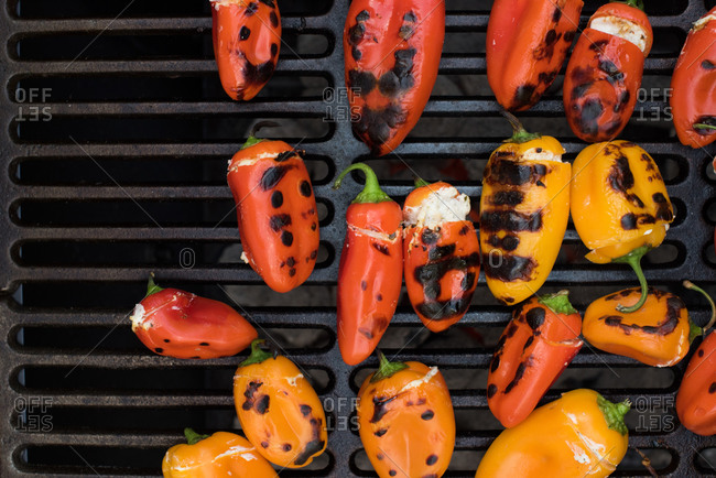 Stuffed hot peppers on a grill