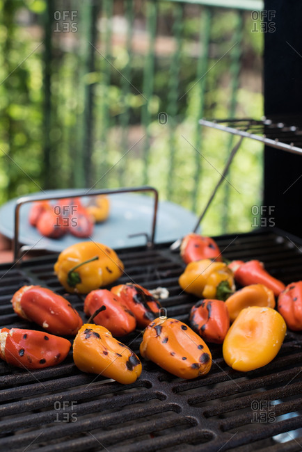 Stuffed hot peppers grilling outside