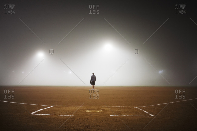 Man on the pitcher's mound in a foggy baseball field
