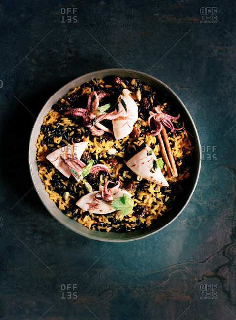 Overhead view of rice dish with fish and squid