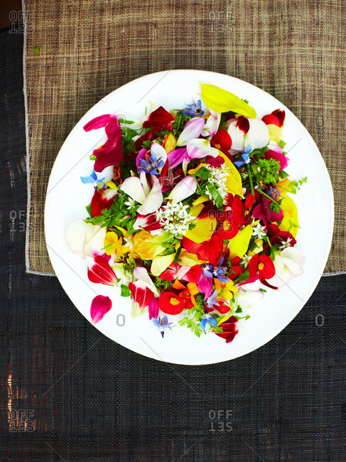 Overhead view of dish of edible flowers