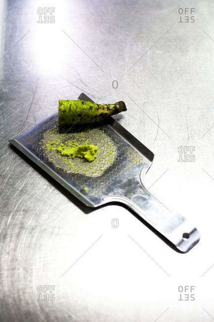 Overhead view of fresh ground wasabi and stem