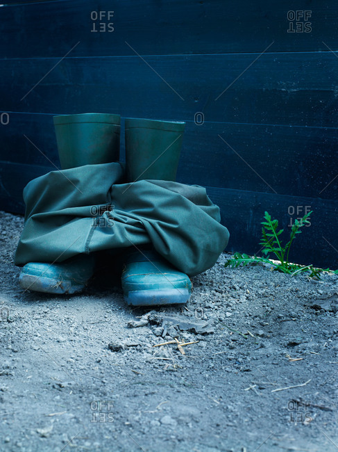 Green boots and waders outside on ground