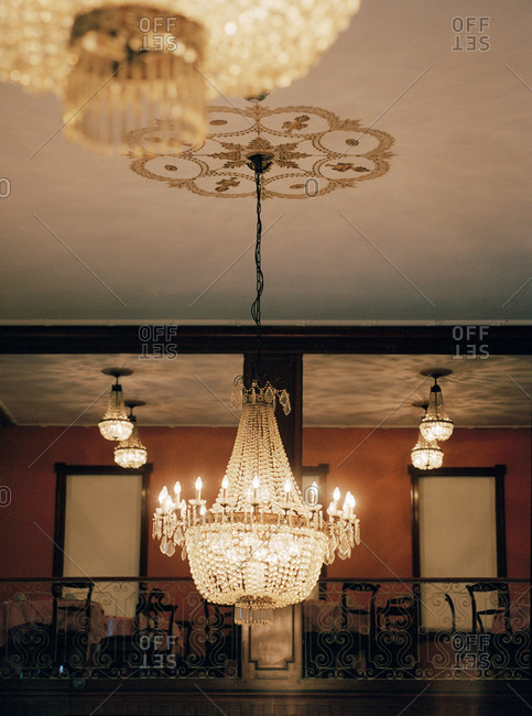 Ornate crystal chandelier and balcony in a dining room