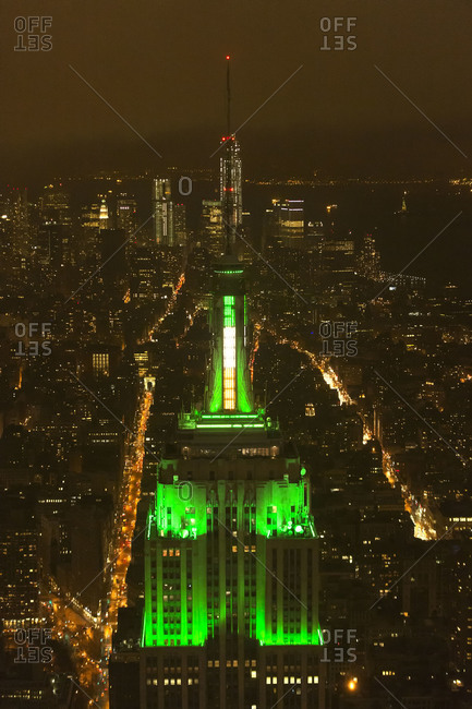 New York City, NY, USA - March 16, 2013: The Empire State Building lit up with green lights on Saint Patrick's Day