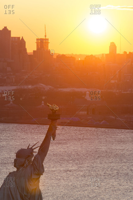 Sunset in New York City with the Statue of Liberty
