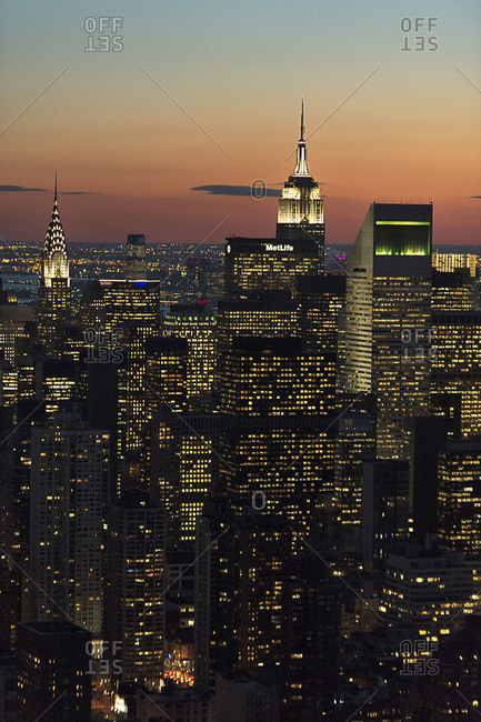 New York City, NY, USA - March 4, 2013: The Empire State Building and the Chrysler Building at dusk