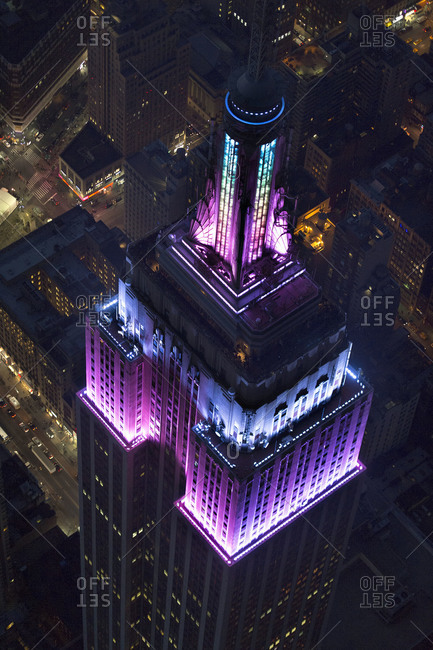 New York City, NY, USA - March 30, 2013: Purple lights illuminating the Empire State Building on Easter