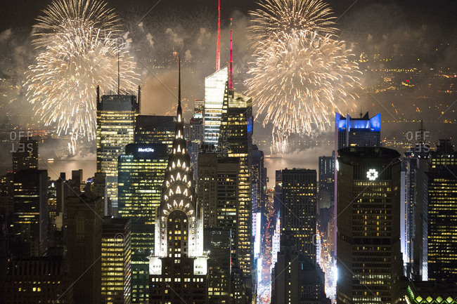 New York City, NY, USA - July 4, 2013: Skyscrapers and fireworks on the 4th of July in New York City, USA