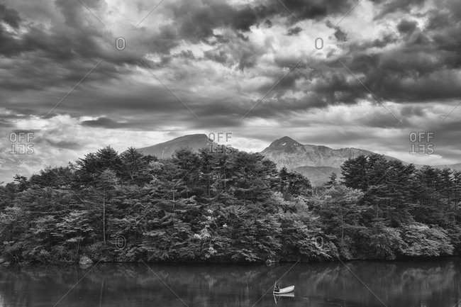 A view of Mount Bandai and a boater on a Goshiki-numa lake in Fukushima, Japan