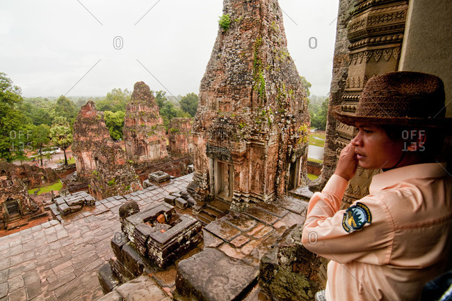 Angkor, Cambodia - September 17, 2012: An official guide at the Pre Rup temple