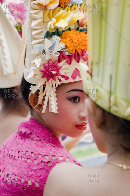 Indonesia - September 9, 2009: A young girl dressed with traditional Indonesian clothes