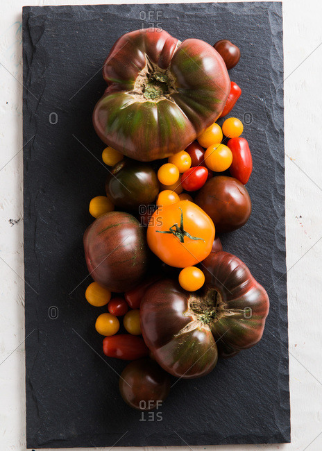 Heirloom tomatoes on a slate tray