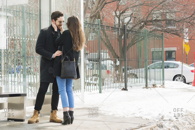 Couple embracing on winter city street