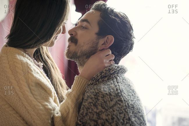 Couple in loving gaze in cafe