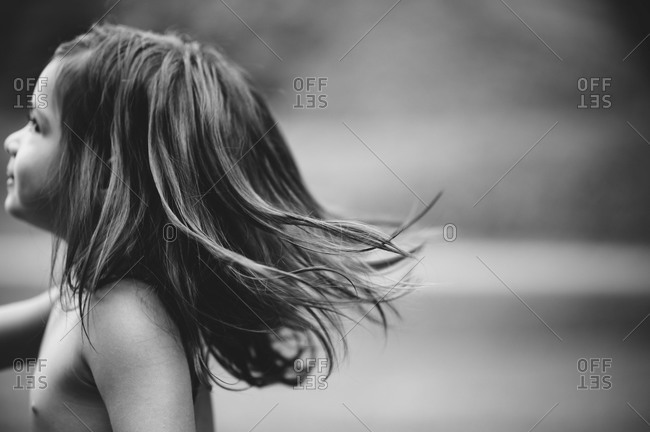 A little girl runs outside