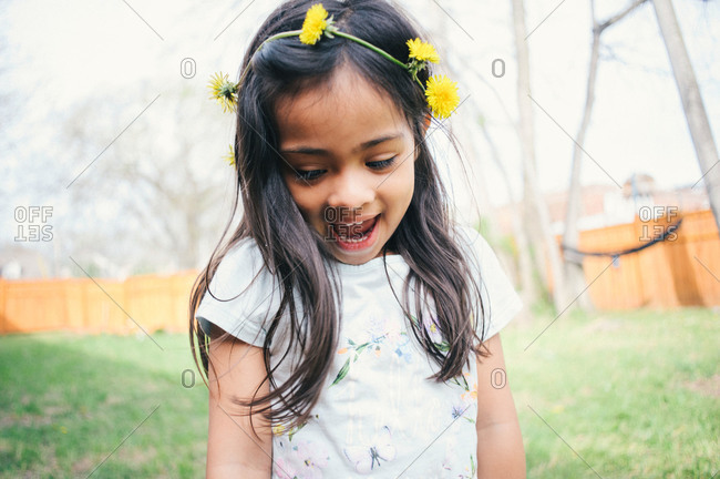 A little girl with a dandelion crown