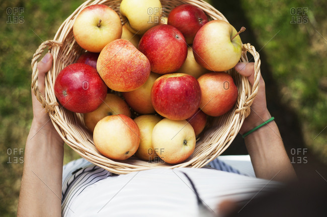 Carrying a basket of apples