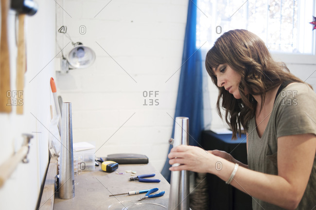 Jewelry maker in her workshop
