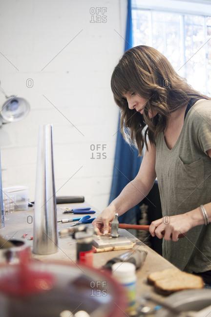 Jewelry maker working in her workshop