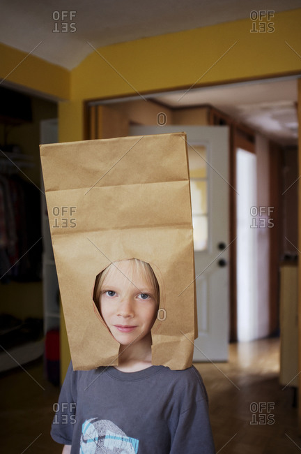 Kid with a paper bag hat