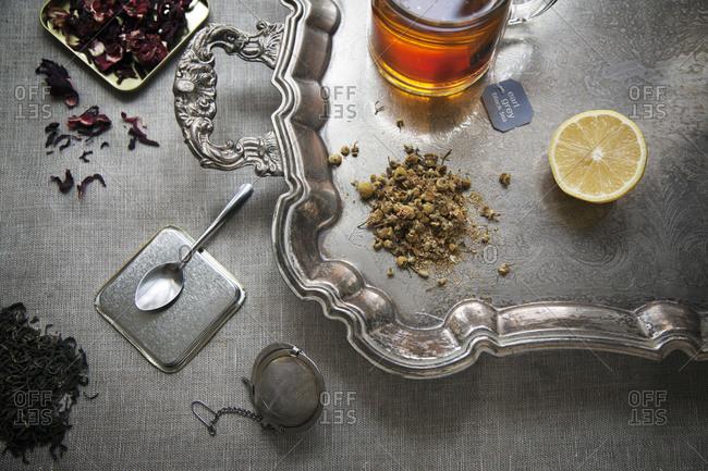 Tea and lemon on a silver platter
