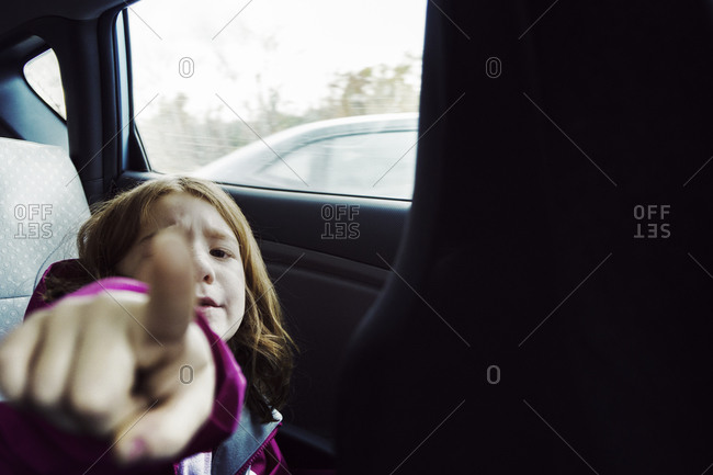 Young girl riding in a car
