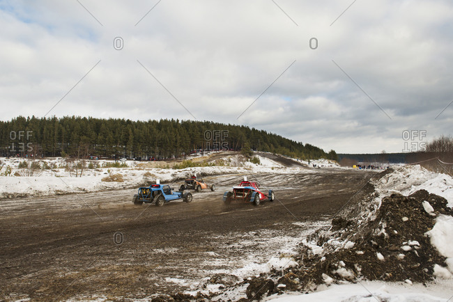 Buggies racing on a dirt track
