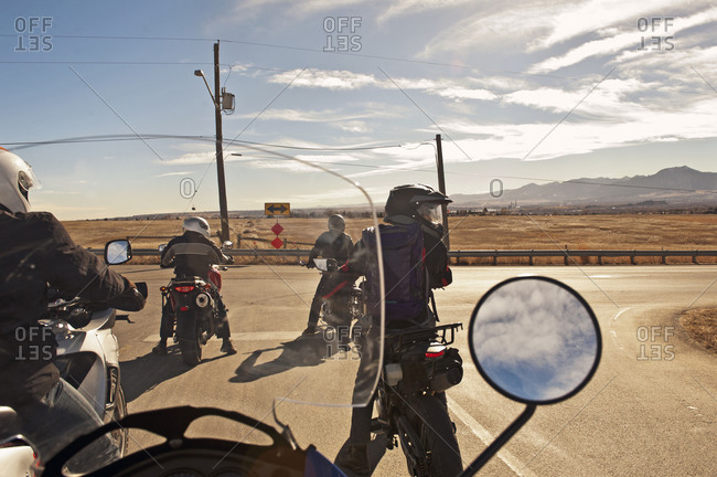 Bikers traveling out on open road