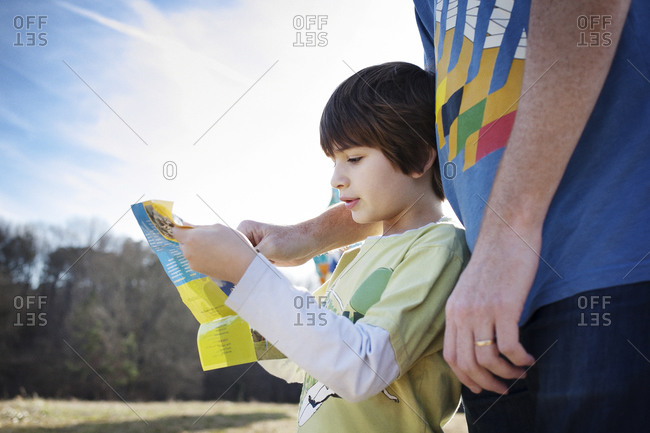 Young boy looking at a map with his father