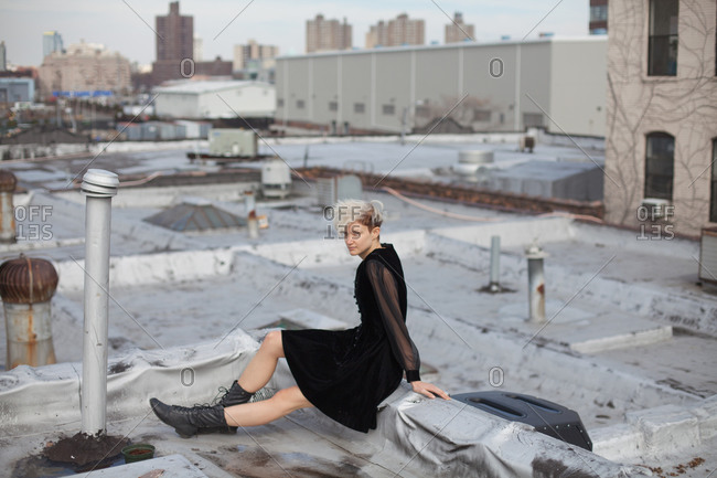A young woman on a rooftop