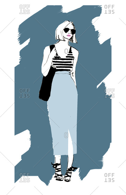 A fashionable woman in a long skirt and striped tank top