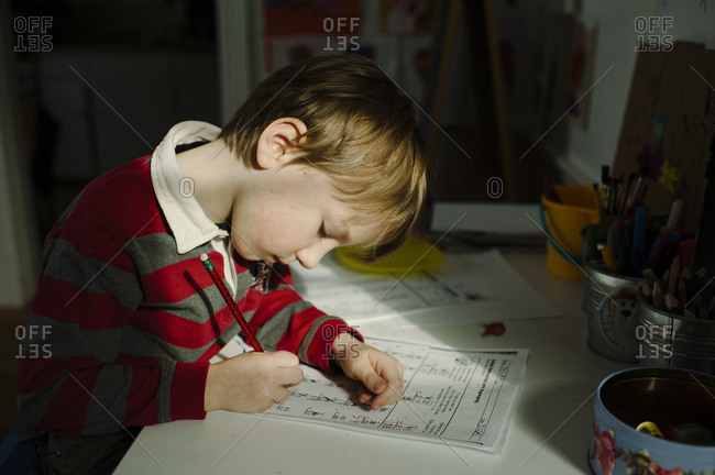 A little boy works on math homework