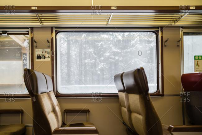 Ebetsu, JAPAN - January 12, 2014: Winter forest view from inside train window