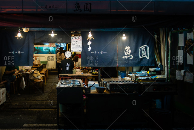 Osaka, Japan - May 19, 2015: Small eatery at night in Osaka, Japan