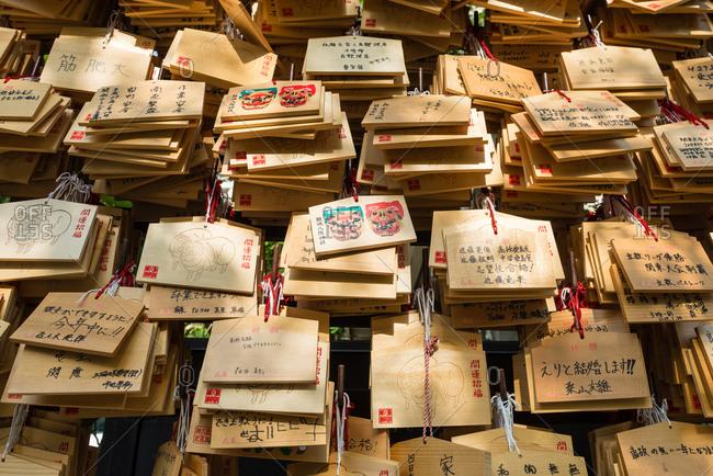 Osaka, Japan - May 19, 2015: Wooden Ema tablets hanging at the Nanbayasaka Shrine, Osaka, Japan