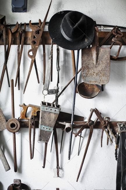 Old tools hanging on wall