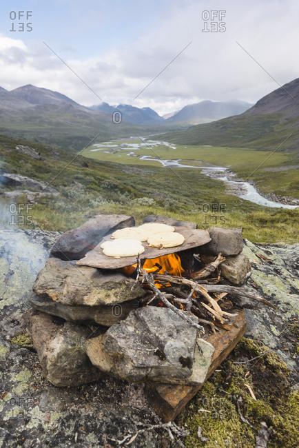 Flat bread baking on campfire
