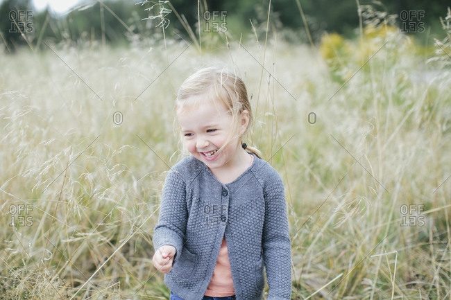 Smiling girl on meadow