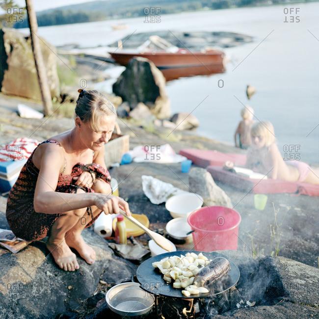 Mother preparing food at water