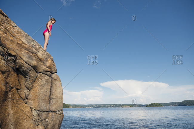 Girl standing on cliff