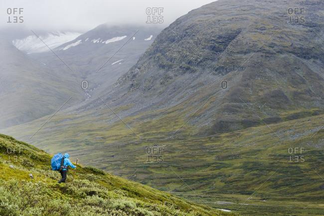 Man hiking down a mountain slope