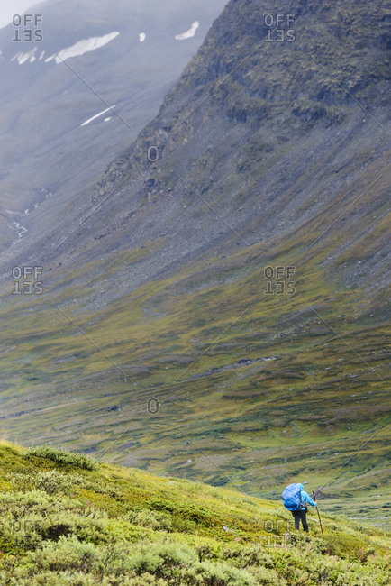 Man hiking down a slope
