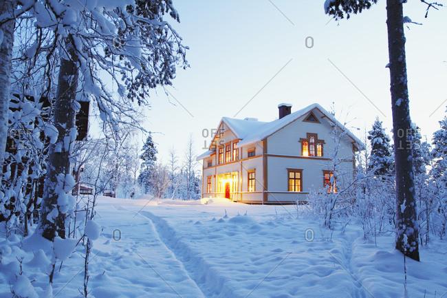 Illuminated white house in winter
