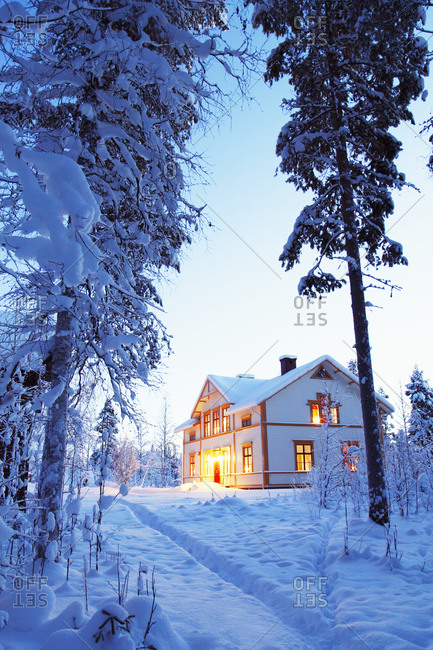 Illuminated house in winter