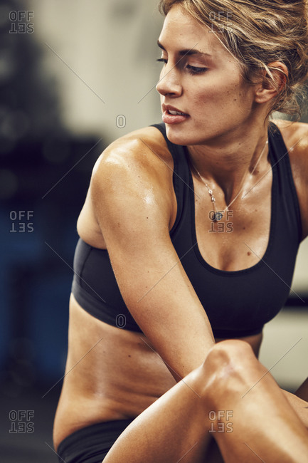Woman in sport clothes stretching in gym
